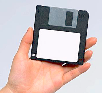 Hand holding a floppy disk